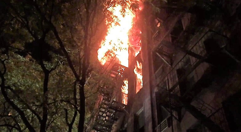 Photo of FDNY's Rescue 1 firefighter rappels from roof to save burned man at fatal 6th alarm