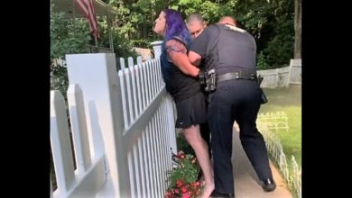 Photo of Woman using green line on her burning home arrested for interfering with firefighters & assault